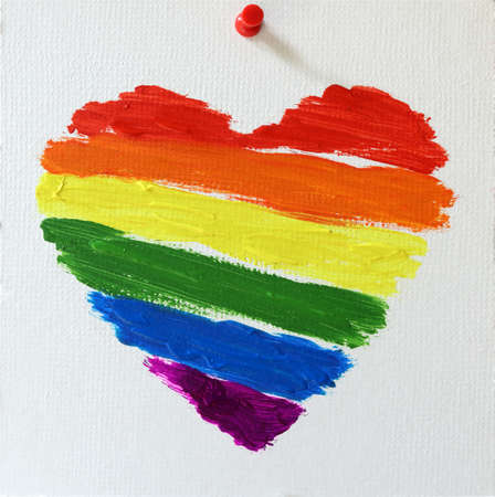 Gay lgbt flag painted rainbow heart on white background
