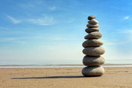 Zen stone balance on the beach