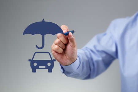 Businessman hand drawing an umbrella above a family car concept for car insurance, protection, security and finance
