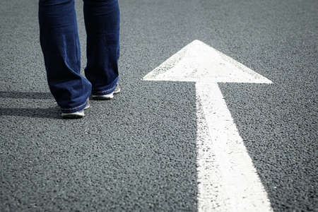Following the white direction arrow on the road