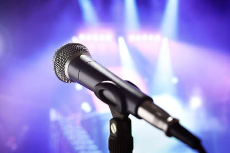 Microphone with stage lighting background