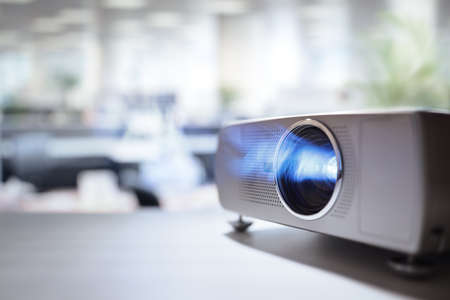 LCD video projector at business conference or lecture in office with copy space Stock Photo