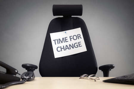 Time for change empty business chair with sign in office concept for motivation, opportunity, and progress