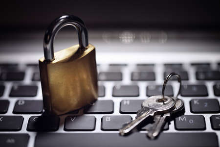 Internet security and network protection concept, padlock and key on laptop