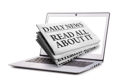 Newspaper read all about it headline through a laptop screen concept for latest online news Banque d'images