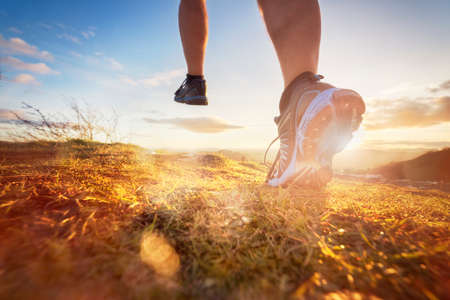 Outdoor cross-country running in morning sunrise concept for exercising, fitness and healthy lifestyle
