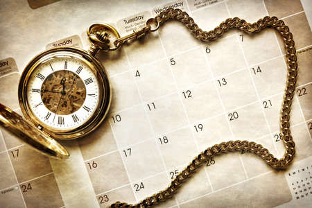 Time management, gold pocket watch on blank calendar background