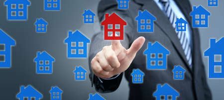Real estate search concept man pressing red house icon on screen