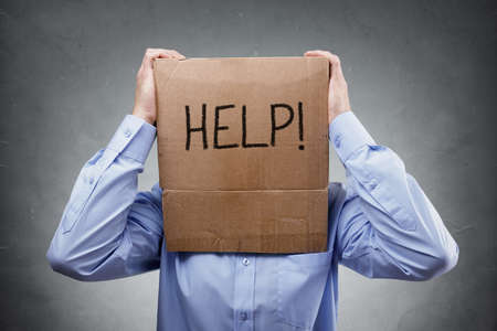 Cardboard box on businessman head asks for help concept for problems, support, overworked or stress 스톡 콘텐츠 - 131760998