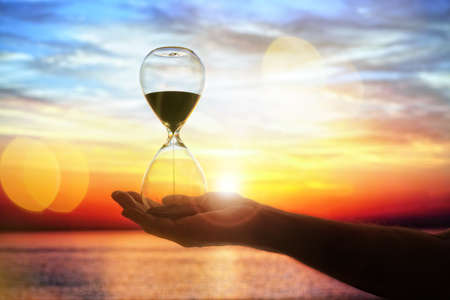 Hourglass time at sunset background with copy space Banque d'images