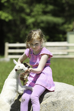 Girl and Her Beloved Goats at a Farm