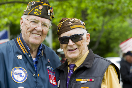 Veterans of World War II at a Memorial Day service. Stok Fotoğraf - 70333728