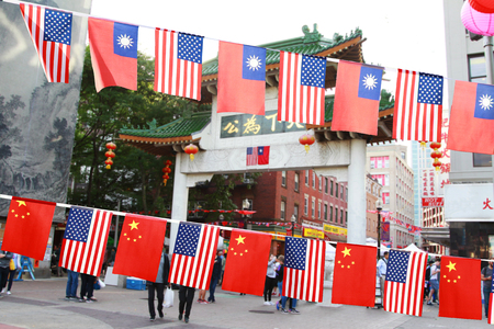 1 Oct is China's National Day, 10 Oct is Taiwan's National Day, Boston Chinatown hangs Chinese flags, Taiwanese flags and American flags celebrating holidays. Editorial