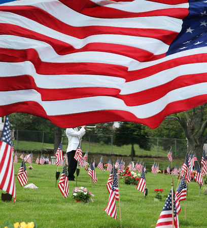Paying respects to fallen comrades of all wars at a cemetery on Memorial Day