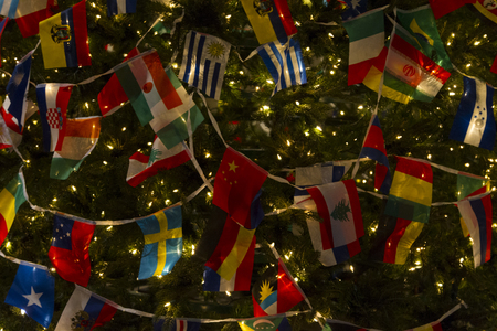 Christmas Tree Decorated with Variety Countries Flags, Wishing World United and Peace in Details Stok Fotoğraf - 115344596