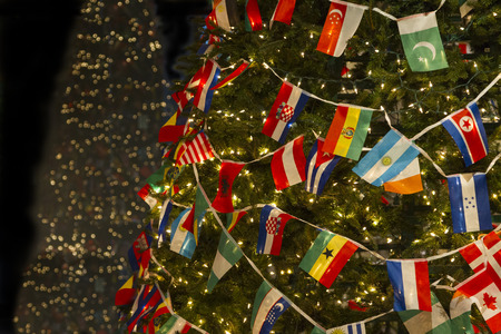 Christmas Tree Decorated with Variety Countries Flags, Wishing World United and Peace in Details