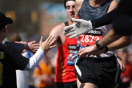 118th Boston Marathon took place in Boston, Massachusetts, on Monday, April 21 (Patriots' Day) 2014. Kids give a high five to Boston Marathon runners. Editöryel