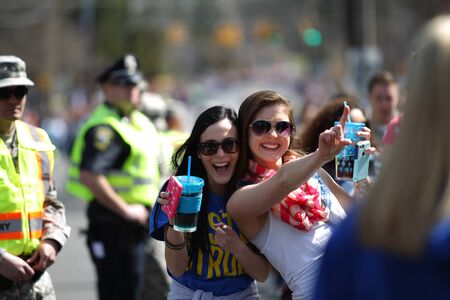 118th Boston Marathon took place in Boston, Massachusetts, on Monday, April 21 (Patriots' Day) 2014. College female student spectators