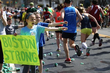 118th Boston Marathon took place in Boston, Massachusetts, on Monday, April 21 (Patriots' Day) 2014. Children spectators offer rings to runners Editöryel
