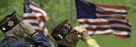 Veterans Saluting at Memorial Day Ceremony May 22, in Lexington, Massachusetts, USA