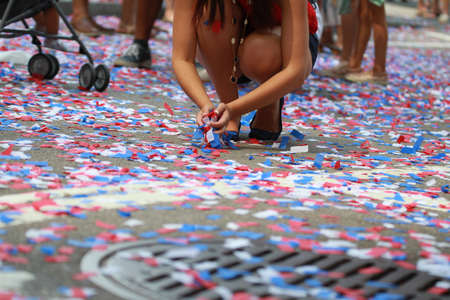 The City of Boston's Independence Day Commemoration Hold on 4th of July in Boston.A Girl Gathered Confetti on the Ground.