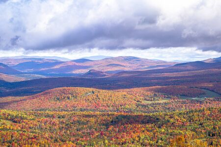 Layers of mountains in fall colors in New England, USA