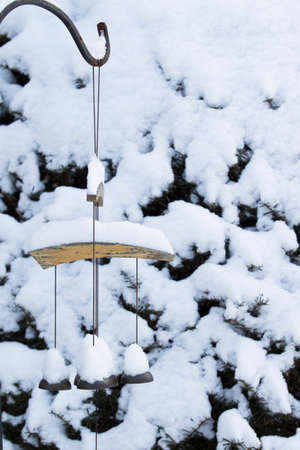 Wind Chimes Covered Snow in Winter, New England, USA