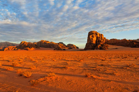 Wadi: A dramatic sky during a sunrise in the desert  Wadi Rum National Park, Jordan  Stock Photo