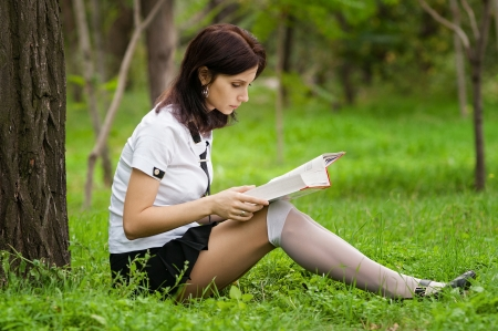 sexy teenage girls: Beautiful student reading the book Stock Photo