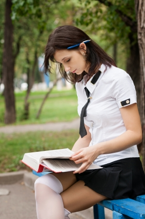 Student reading a book on the street photo
