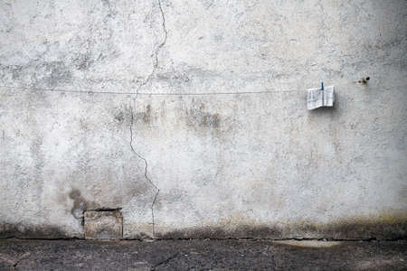 madhouse: a rag is hanging on the wall. The atmosphere is sinister, malevolent. Ther's a crack on the wall. Stock Photo