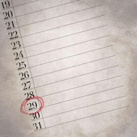 오래된 텍스처가있는 캘린더는 해당 월의 29 번째 날을 표시하며, 하루의 세부 사항은 빨간색 원으로 표시됩니다.