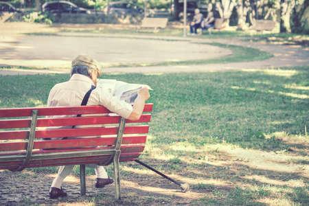 average guy: Senior man reading news, free time outdoor