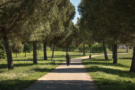 grandma walks alone at the park, loneliness concept elderly abandonment Stock Photo