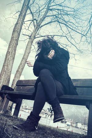 lady with mental illness, dark model expressing psychological problems