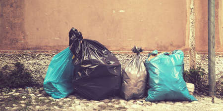 garbage bags on the road background picture, trash on sidewalk Stock Photo