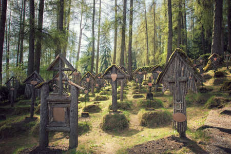 war cemetery in Bruneck, the tombs are in the wood Stock Photo
