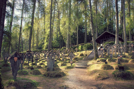 cemetery in Brunico (Italy), the tombs are in the wood