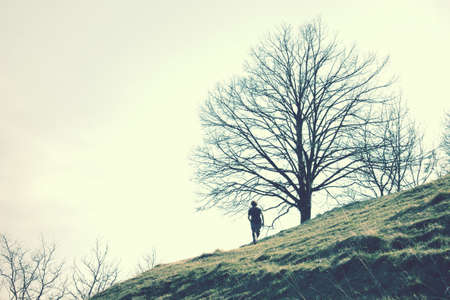 man on a hill, in the mountain with vintage effect.