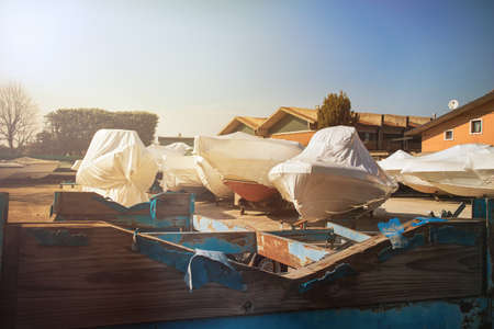 boatyard, maintenance of boats (the hulls are covered with plastic sheeting)