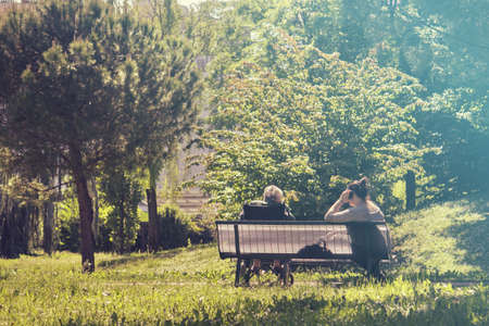 senior and caretaker, the couple of women resting at the park