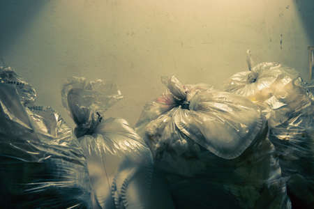 garbage bags with copy space, mixed waste (dramatic dark tone effect)