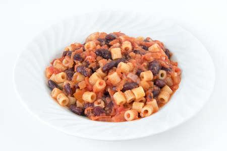 traditional italian pasta e fagioli. the sauce is made of beans, tomatoes and onions Фото со стока
