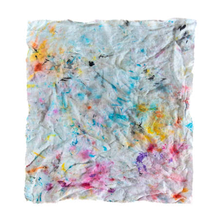 dirty cloth of paint on white background. Rag with color spots Фото со стока