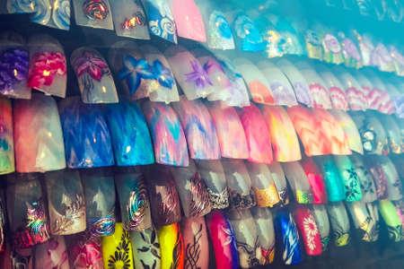set of colored finger nails, colorful decorations feminine nail art (selective focus) Фото со стока