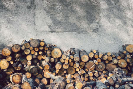 Firewood against the wall. front view of pieces of wood (copy space available on the top) Фото со стока