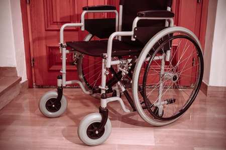 empty wheelchair, the object is indoor at home Фото со стока