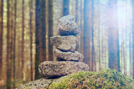 stability of stones in the forest, Stack of rocks (zen meditation and concentration in the nature concept)