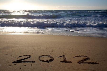 2012 written on the beach horizontal with waves photo