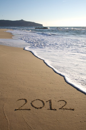 2012 written on the beach vertical in south of italy photo
